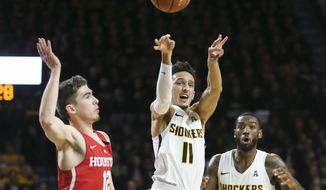 Wichita State guard Landry Shamet looks for a pass against Houston guard Wes VanBeck during the first half of an NCAA college basketball game in Wichita, Kan., Thursday, Jan. 4, 2018. (Travis Heying/The Wichita Eagle via AP)