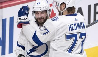 Tampa Bay Lightning's Nikita Kucherov(86) is congratulated by teammate Victor Hedman after scoring the against the Montreal Canadiens during the second period of an NHL hockey game Thursday, Jan. 4, 2018, in Montreal. (Ryan Remiorz/The Canadian Press via AP)