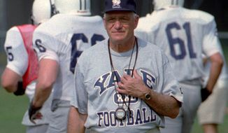 FILE - In this Aug. 27, 1996, file photo, Yale University head football coach Carmen Cozza walks across the practice field in West Haven, Conn. Cozza, who led Yale to a share of 10 Ivy League titles during 32 years as coach died Thursday, Jan. 4, 2018, the university said. He was 87. (AP Photo/Bob Child, File)
