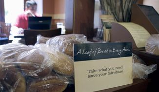 FILE - In this May 18, 2010 file photo, loaves of bread sits on a table at St. Louis Bread Co. Cares Community Cafe, part of Panera, in Clayton, Mo. The restaurant, where patrons pay as much or little as they want for a meal, is closing its doors Tuesday, Jan. 9, 2018. Founder and executive chairman Ron Shaich said it is closing because it was on a month-to-month lease and the store required a big investment. (AP Photo/Jeff Roberson, File)