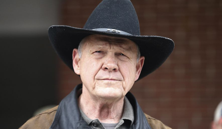 In this Dec. 12, 2017, file photo, U.S. Senate candidate Roy Moore speaks to the media after he rode in on a horse to vote in Gallant, Ala. (AP Photo/Brynn Anderson, File)