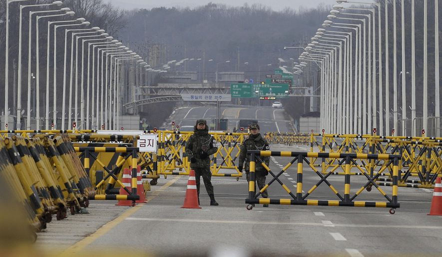 South Korean army soldiers stand guard on Unification Bridge, which leads to the demilitarized zone, near the border village of Panmunjom in Paju, South Korea, Thursday, Jan 4, 2018. North Korean leader Kim Jong Un reopened a key cross-border communication channel with South Korea for the first time in nearly two years Wednesday as the rivals explored the possibility of sitting down and talking after months of acrimony and fears of war. (AP Photo/Ahn Young-joon)