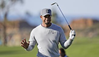 FILE - In this Jan. 27, 2017, file photo, Tiger Woods reacts after hitting out of the rough on the ninth hole of the North Course during the second round of the Farmers Insurance Open golf tournament at Torrey Pines Golf Course in San Diego. Woods announced Thursday, Jan. 4, 2018, that he is playing twice in California over the next six week as he begins another comeback on the PGA Tour from back surgery. He will play the Farmers Insurance Open on Jan. 25 at Torrey Pines, and the Genesis Open at Riviera in Los Angeles that starts on Feb. 15. (AP Photo/Gregory Bull, File) **FILE**