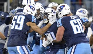 FILE - In this Sunday, Dec. 31, 2017, file photo, Tennessee Titans free safety Kevin Byard (31) celebrates with Wesley Woodyard (59) and Ben Jones (60) after intercepting a pass against the Jacksonville Jaguars to stop their final drive in the last seconds of the fourth quarter in an NFL football game in Nashville, Tenn.  Bayard heads into his first playoff game Saturday in Kansas City leading the NFL in takeaways with 10 and tied for the league-lead with eight interceptions. (AP Photo/Mark Zaleski, File)