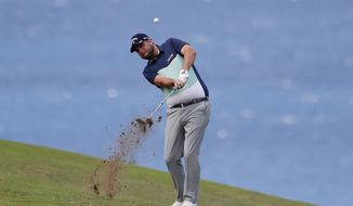 Marc Leishman hits from the fourth fairway during the first round of the Tournament of Champions golf event, Thursday, Jan. 4, 2018, at Kapalua Plantation Course in Kapalua, Hawaii. (AP Photo/Matt York)