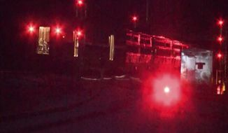 In this image made from video an Amtrak passenger train sits derailed in the snow, Wednesday, Jan. 3, 2018, in Savannah, Georgia. An Amtrak spokesman has said three cars on a passenger train have derailed in Savannah, Georgia, but there were no injuries reported among the crew and 311 passengers aboard. (WTOC via AP)