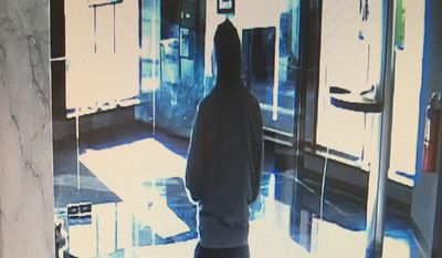 Surveillance camera photo of a bank robbery suspect who held up a TB Bank in Arlington County, Va., on Jan. 5, 2018. (Arlington County Police Dept.)