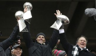 "In this Feb. 7, 2017, file photo, New England Patriots quarterback Tom Brady holds up a Super Bowl trophy along with head coach Bill Belichick, right, and team owner Robert Kraft, left, during a rally in Boston to celebrate a 34-28 win over the Atlanta Falcons in the NFL Super Bowl 51 football game in Houston. The Patriots say a report suggesting a rift involving Kraft, Belichick and Brady is ""flat-out inaccurate."" The three released a joint statement Friday, Jan. 5, 2018, hours after an ESPN report, citing undisclosed sources, detailed an array of tension. (AP Photo/Elise Amendola, File)"