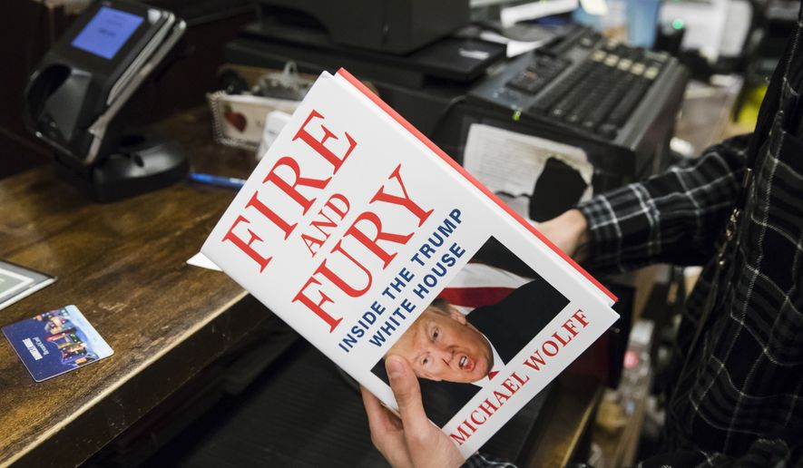 "A salesperson rings up a copy of the book ""Fire and Fury: Inside the Trump White House"" by Michael Wolff at a Barnes & Noble store in Philadelphia, Friday, Jan. 5, 2018. (AP Photo/Matt Rourke)"