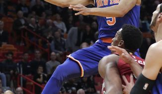 New York Knicks' Courtney Lee (5) drives past Miami Heat's Hassan Whiteside during the first half of an NBA basketball game, Friday, Jan. 5, 2018, in Miami. (AP Photo/Lynne Sladky)