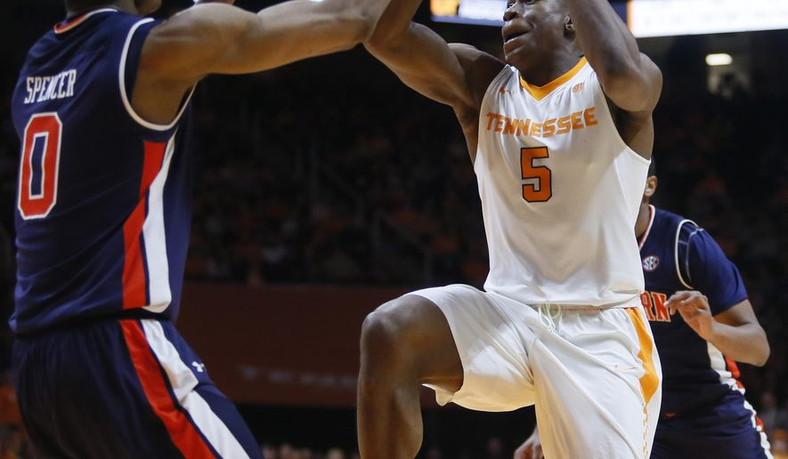 Tennessee forward Admiral Schofield (5) is defended by Auburn forward Horace Spencer (0) as he drives the ball toward the basket in the first half of an NCAA college basketball game Tuesday, Jan. 2, 2018, in Knoxville, Tenn. (AP Photo/Crystal LoGiudice)