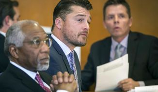 FILE - In this Nov. 27, 2017, file photo, Iowa farmer and former TV reality show celebrity Chris Souleslistens during a hearing in Buchanan County District Court in Independence, Iowa. Soules is fighting to avoid prison after driving his pickup into the back of a tractor and killing a neighbor in April 2017. He lost a legal battle Friday, Jan. 5, 2018, in the felony case against him when a judge dismissed his constitutional challenge to an Iowa law requiring the surviving driver in a fatal accident to remain at the scene until police arrive. It goes beyond the statutes of many states. His trial is set for Jan. 18. (Rodney White/The Des Moines Register via AP, Pool, File)