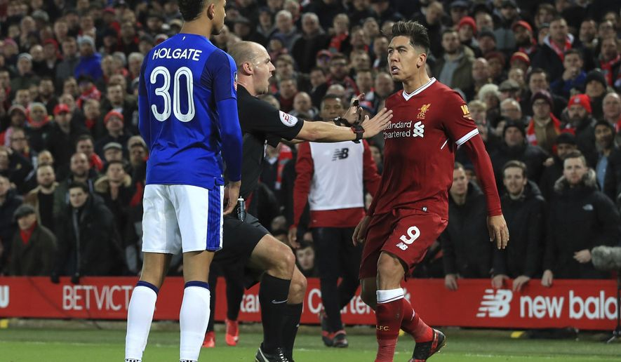 Tempers flare between Everton's Mason Holgate, left, and Liverpool's Roberto Firmino during the English FA Cup Third Round soccer match between Liverpool and Everton at Anfield in Liverpool, England, Friday, Jan. 5, 2018. (Peter Byrne/PA via AP)