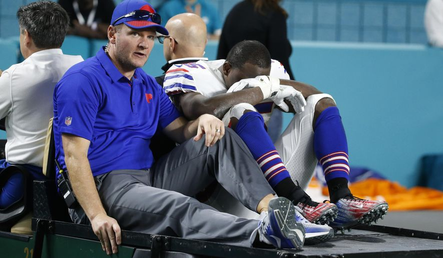 FILE - In this Sunday, Dec. 31, 2017, file photo, Buffalo Bills running back LeSean McCoy (25) is carted off the field after he was injured in the second half of an NFL football game against the Miami Dolphins in Miami Gardens, Fla. McCoy says he's making progress with his right ankle injury but his status is uncertain for Sunday's AFC wild-card playoff game against the Jacksonville Jaguars.  (AP Photo/Wilfredo Lee, File)