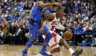Dallas Mavericks guard Yogi Ferrell (11) fouls Chicago Bulls guard Kris Dunn (32) during the first half of an NBA basketball game in Dallas, Friday, Jan. 5, 2018. (AP Photo/Michael Ainsworth)