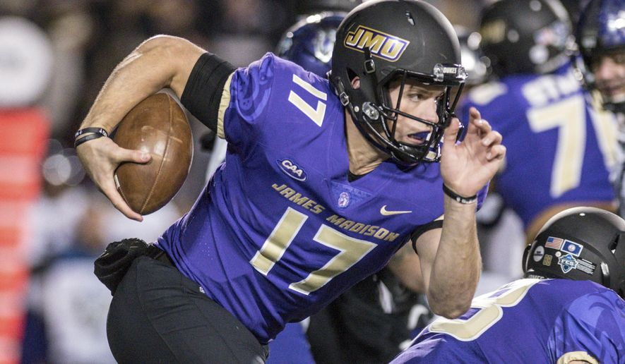 FILE - In this Dec. 8, 2017, file photo, James Madison quarterback Bryan Schor carries the ball against Weber State during the first half of an NCAA college football game in the quarterfinals of the FCS playoffs in Harrisonburg, Va. James Madison is one win from a second straight FCS championship. Standing in the way in Saturday's title game is a team quite familiar with that drill: North Dakota State. (Daniel Lin/Daily News-Record via AP, File)/Daily News-Record via AP)