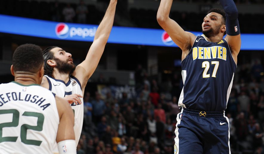 Denver Nuggets guard Jamal Murray, right, goes up to shoot over Utah Jazz guard Ricky Rubio, back left, of Spain, and forward Thabo Sefolosha, of Switzerland, in the first half of an NBA basketball game Friday, Jan. 5, 2018, in Denver. (AP Photo/David Zalubowski)