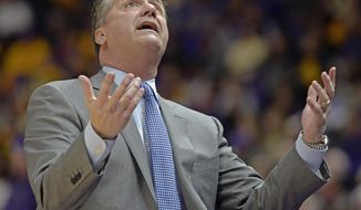 Kentucky head coach John Calipari questions play on the floor in the first half of an NCAA college basketball game, Wednesday, Jan. 3, 2018, in Baton Rouge, La. (AP Photo/Bill Feig)