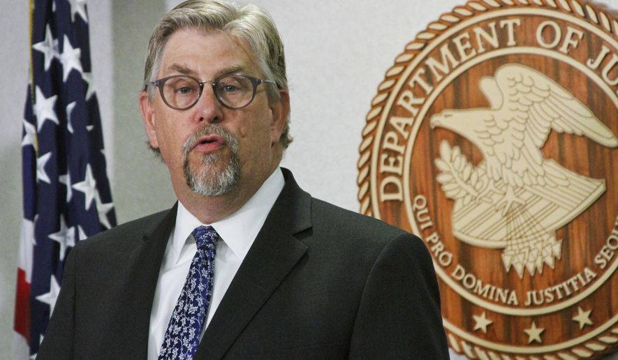 FILE - In this July 27, 2017 file photo, Bryan Schroder, then acting U.S. Attorney for Alaska, addresses reporters in Anchorage, Alaska. U.S. Attorney General Jeff Sessions has put the top federal prosecutors in states that have legalized recreational marijuana back in charge of deciding whether to press pot cases there, but huge obstacles remain, starting with the fact that many of those U.S. attorneys are either brand new to the job or Obama-era holdovers. It's was unclear how Alaska's new U.S. attorney,  Schroder, will handle marijuana in the Republican state with Libertarian leanings. Schroder said in a statement that one of his office's key principals is to follow federal law enforcement priorities, both at the national and local levels. (AP Photo/Mark Thiessen, File)