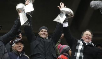 "FILE - In this Feb. 7, 2017, file photo, New England Patriots quarterback Tom Brady holds up a Super Bowl trophy along with head coach Bill Belichick, right, and team owner Robert Kraft, left, during a rally in Boston to celebrate a 34-28 win over the Atlanta Falcons in the NFL Super Bowl 51 football game in Houston. The Patriots say a report suggesting a rift involving Kraft, Belichick and Brady is ""flat-out inaccurate."" The three released a joint statement Friday, Jan. 5, 2018, hours after an ESPN report, citing undisclosed sources, detailed an array of tension. (AP Photo/Elise Amendola, File)"
