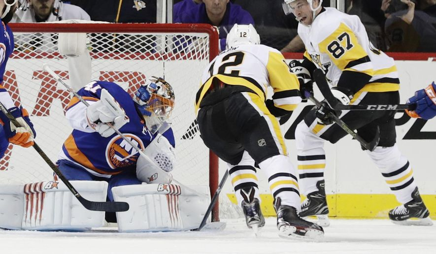 Pittsburgh Penguins' Sidney Crosby (87) reacts after scoring a goal during the second period of an NHL hockey game as New York Islanders goaltender Jaroslav Halak (41) watches Friday, Jan. 5, 2018, in New York. (AP Photo/Frank Franklin II)