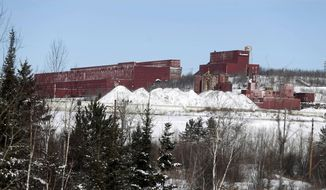 FILE - In this Feb. 10, 2016, file photo, the closed LTV Steel taconite plant sits idle near Hoyt Lakes, Minn. The site, which closed in 2001, may return to life as part of Minnesota's first copper-nickel mine, owned by PolyMet Mining Corp. The contentious copper-nickel mine in northeastern Minnesota took another step forward Friday, Jan. 5, 2018, when state regulators released a crucial draft permit for public comment. (AP Photo/Jim Mone, File)