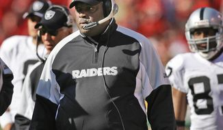 FILE - In this Nov. 19, 2006, file photo, Oakland Raiders coach Art Shell works the sidelines during the team's NFL football game against the Kansas City Chiefs in Kansas City, Mo. Shell was let go by the Raiders following the 1994 season as late owner Al Davis wanted a fresh start for the team for its move back to Oakland. Davis later said he regretted the move and brought Shell back in 2006. Shell had spent his first six years away from the Raiders as an assistant coach but had been out of the profession entirely for five seasons when Davis hired him a second time. (AP Photo/Ed Zurga, File)