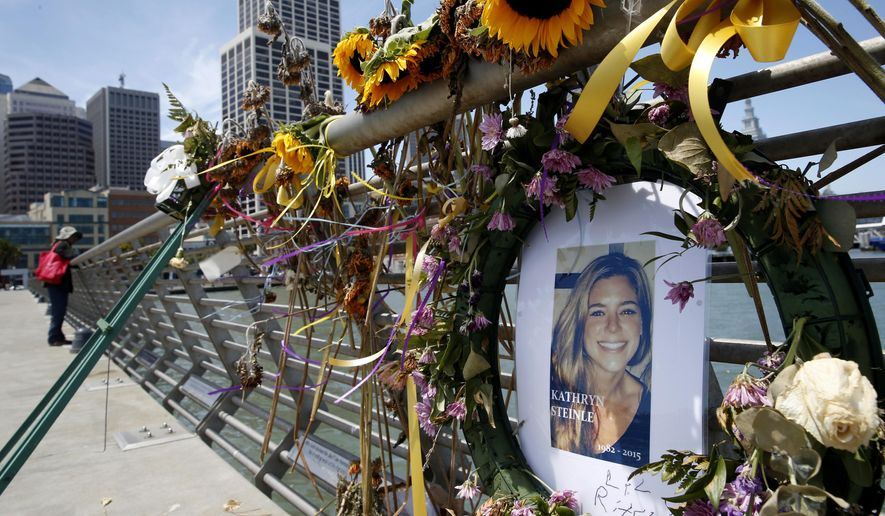 In this July 17, 2015, file photo, flowers and a portrait of Kate Steinle remain at a memorial site on Pier 14 in San Francisco. (Paul Chinn/San Francisco Chronicle via AP, File)