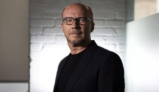 """FILE - In this Sept. 6, 204 file photo, director Paul Haggis poses for a photo in Toronto during the 2014 Toronto International Film Festival. A December 2017 civil lawsuit charging the Oscar-winning filmmaker with rape has prompted three other women to come forward with their own accusations, including a publicist who says he forced her to perform oral sex, then raped her. Haggis has denied the allegations in the lawsuit, and when asked about the new accusations, his lawyer said, """"He didn't rape anybody."""" (AP Photo/The Canadian Press, Darren Calabrese, File)"""