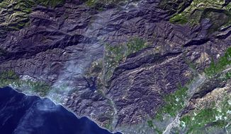 This Dec. 27, 2017 image provided by NASA/JPL-Caltech, taken from the NASA Terra satellite, posted by the Jet Propulsion Laboratory of the California Institute of Technology Friday, Jan. 5, 2018, shows the wide area of destruction of the Thomas fire, the largest wildfire in California's recorded history. The National Weather Service says widespread rain is expected Monday, Jan. 8, into Wednesday, with possible downpours and debris flows in recent wildfire burn areas. (NASA/Jet Propulsion Laboratory/CalTech via AP)