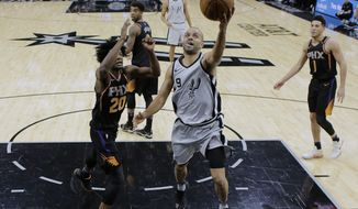 San Antonio Spurs guard Tony Parker (9) drives past Phoenix Suns forward Josh Jackson (20) during the first half of an NBA basketball game Friday, Jan. 5, 2018, in San Antonio. (AP Photo/Eric Gay)