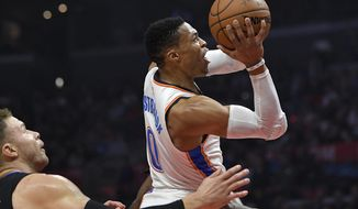 Oklahoma City Thunder guard Russell Westbrook, right, shoots as Los Angeles Clippers forward Blake Griffin defends during the first half of an NBA basketball game, Thursday, Jan. 4, 2018, in Los Angeles. (AP Photo/Mark J. Terrill)