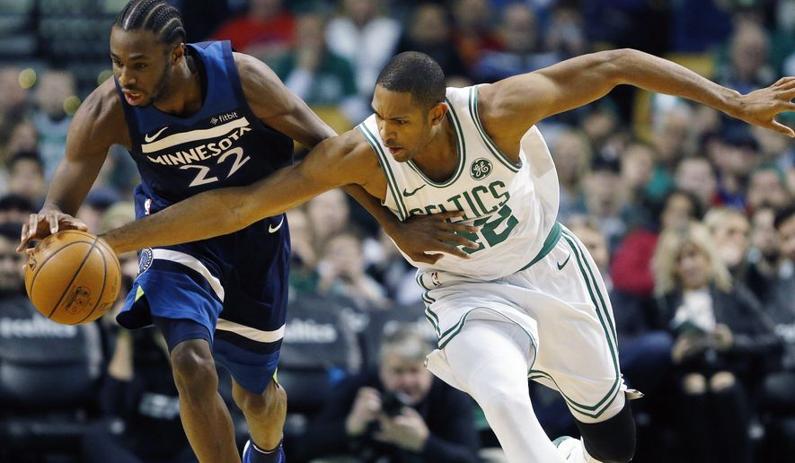 Boston Celtics' Al Horford, right, and Minnesota Timberwolves' Andrew Wiggins race for a loose ball during the third quarter of an NBA basketball in Boston, Friday, Jan. 5, 2018. The Celtics won 91-84. (AP Photo/Michael Dwyer)