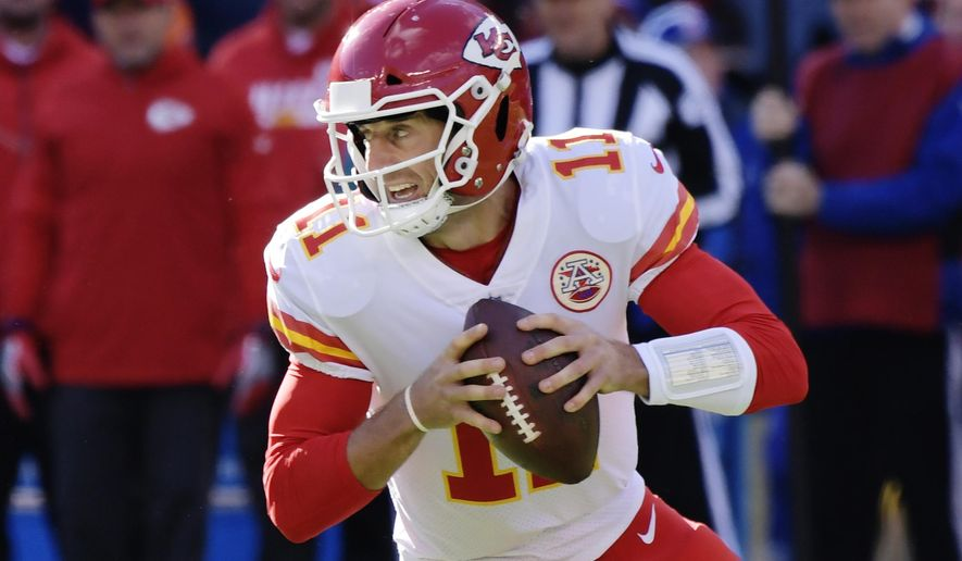 FILE - In this Nov. 19, 2017, file photo, Kansas City Chiefs quarterback Alex Smith (11) looks to pass during the first half of an NFL football game against the New York Giants, in East Rutherford, N.J. The Chiefs and Tennessee Titans meet in a wild-card playoff game in Kansas City on Saturday, Jan . 6, 2018. (AP Photo/Bill Kostroun, File)