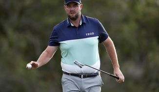 Marc Leishman waves to the crowd on the 18th green during the first round of the Tournament of Champions golf event, Thursday, Jan. 4, 2018, at Kapalua Plantation Course in Kapalua, Hawaii. (AP Photo/Matt York)