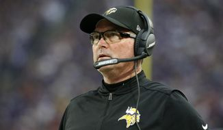 """FILE - In this Dec. 17, 2017, file photo, Minnesota Vikings head coach Mike Zimmer stands on the sideline during the first half of an NFL football game against the Cincinnati Bengals in Minneapolis. No team in the NFL this season allowed fewer yards or fewer points than the Vikings, which means no team in the playoffs is better suited to make true the """"defense wins championships"""" mantra than them. (AP Photo/Bruce Kluckhohn, File)"""