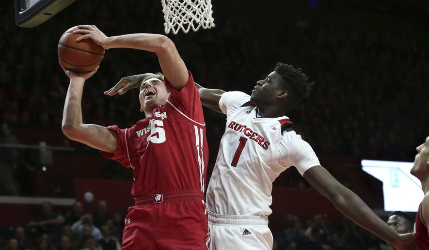 Wisconsin's Nate Reuvers (35) shoots as Rutgers' Candido Sa (1) defends during the first half of an NCAA college basketball game Friday, Jan. 5, 2018, in Piscataway N.J. (AP Photo/Mel Evans)