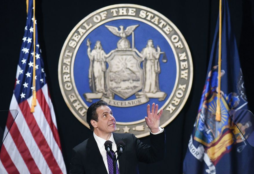 In this Wednesday, Jan. 3, 2018 file photo, New York Gov. Andrew Cuomo makes reference to his father Mario Cuomo as he delivers his state of the state address at the Empire State Plaza Convention Center in Albany, N.Y. (AP Photo/Hans Pennink)