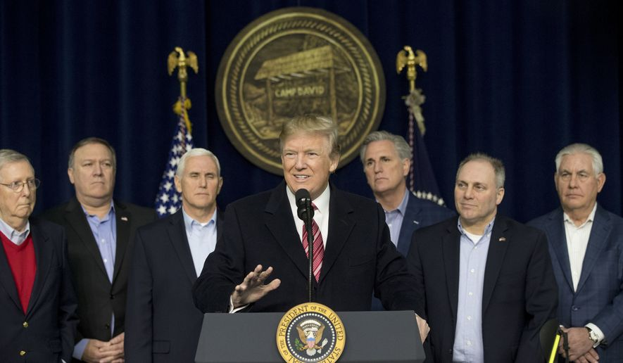 President Donald Trump, center, accompanied by from left, Senate Majority Leader Mitch McConnell of Ky., Vice President Mike Pence, House Majority Leader Kevin McCarthy of Calif., House Majority Whip Steve Scalise, R-La., Secretary of State Rex Tillerson, speaks after participating in a Congressional Republican Leadership Retreat at Camp David, Md., Saturday, Jan. 6, 2018. (AP Photo/Andrew Harnik)