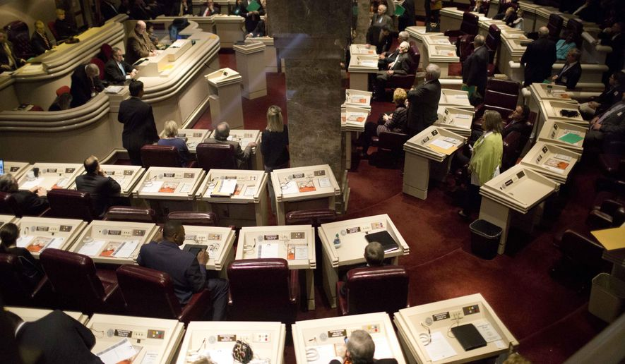FILE - In this March 3, 2015 file photo, Alabama representatives prepare for the opening session in the house of representatives chambers at the State House in Montgomery, Ala. Alabama lawmakers return to Montgomery on Tuesday, Jan. 9, 2018,  to begin the 2018 legislative session that comes at the start of an election year. The session is expected to dominated by two major budgetary issues: Prisons and Children's Health Insurance Program. (AP Photo/Brynn Anderson, File)