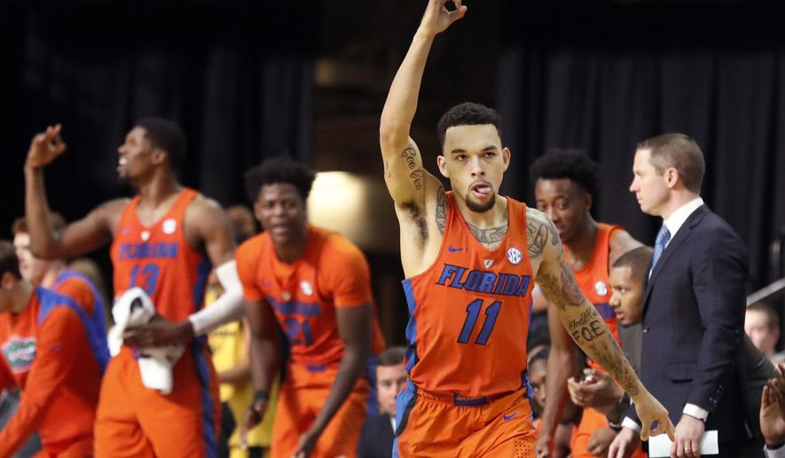 Florida's Chris Chiozza (11) celebrates after hitting a 3-point basket during the second half of an NCAA college basketball game against Missouri, Saturday, Jan. 6, 2018, in Columbia, Mo. Florida won 77-75. (AP Photo/Jeff Roberson)
