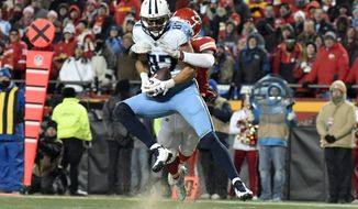 Tennessee Titans wide receiver Eric Decker (87) makes a 22-yard touchdown catch in front of Kansas City Chiefs defensive back Eric Murray during the second half of an NFL wild-card playoff football game in Kansas City, Mo., Saturday, Jan. 6, 2018. The Titans won 22-21. (AP Photo/Ed Zurga)