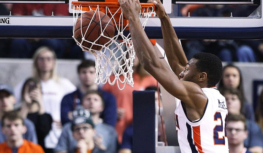 Auburn forward Anfernee McLemore dunks against Arkansas during the first half of an NCAA college basketball game, Saturday, Jan. 6, 2018, in Auburn, Ala. (AP Photo/Brynn Anderson)