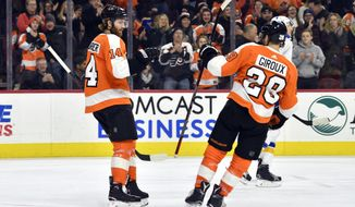 Philadelphia Flyers' Sean Couturier, left, and Claude Giroux celebrate after Couturier scored a goal during the second period of an NHL hockey game against the St. Louis Blues, Saturday, Jan. 6, 2018, in Philadelphia. (AP Photo/Derik Hamilton)