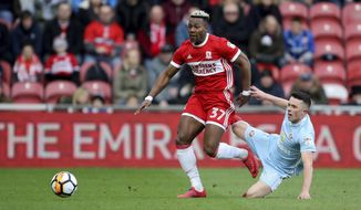 Middlesbrough's Adama Traore and Sunderland's George Honeyman, right, during the FA Cup, third round match at the Riverside Stadium in Middlesbrough, England, Saturday Jan. 6, 2018. (Richard Sellers/PA via AP)