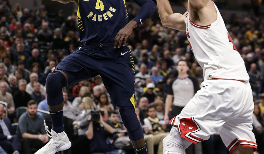 Indiana Pacers guard Victor Oladipo (4) shoots in front of Chicago Bulls center Robin Lopez during the second half of an NBA basketball game in Indianapolis, Saturday, Jan. 6, 2018. The Pacers won 125-86. (AP Photo/AJ Mast)