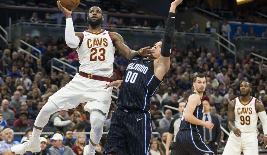 Cleveland Cavaliers forward LeBron James (23) shoots over Orlando Magic forward Aaron Gordon (00) during the first half of an NBA basketball game in Orlando, Fla., Saturday, Jan. 6, 2018. (AP Photo/Willie J. Allen Jr.)