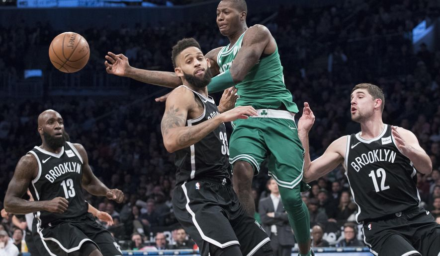 Boston Celtics guard Terry Rozier, center, moves the ball around Brooklyn Nets guard Allen Crabbe (33) during the second half of an NBA basketball game Saturday, Jan. 6, 2018, in New York. (AP Photo/Mary Altaffer)