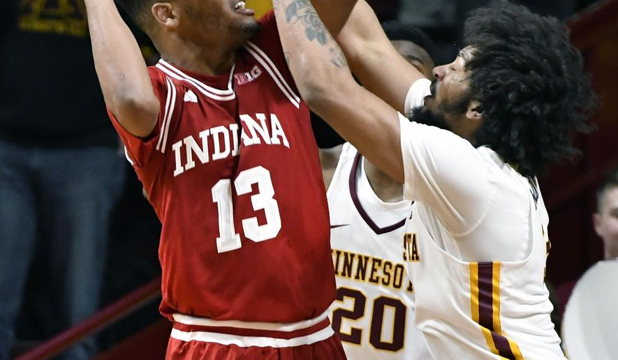 Indiana's Juwan Morgan, left, eyes the basket as Minnesota's Jordan Murphy defends in the second half of an NCAA college basketball game, Saturday, Jan. 6, 2018, in Minneapolis. Morgan scored 20 points in Indiana's 75-71 win. (AP Photo/Jim Mone)