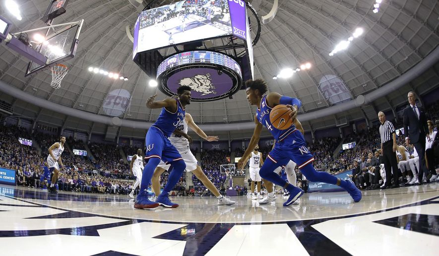 Kansas guard Devonte' Graham (4) drives inside against TCU as Kansas center Udoka Azubuike (35) watches during the first half of an NCAA college basketball game Saturday, Jan. 6, 2018, in Fort Worth, Texas. (AP Photo/Ron Jenkins)